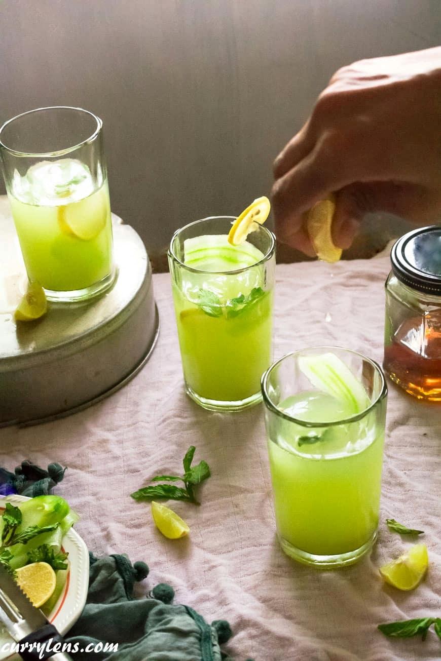 adding dash of lime to cucumber mint lemonde