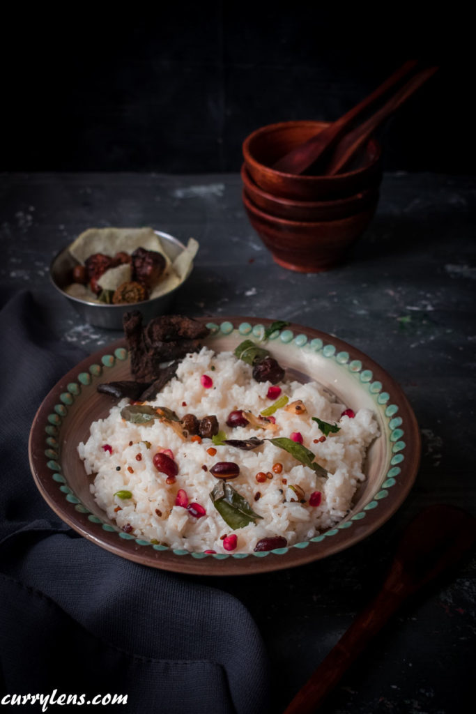Curd rice topped with Pomegranate arils and grapes